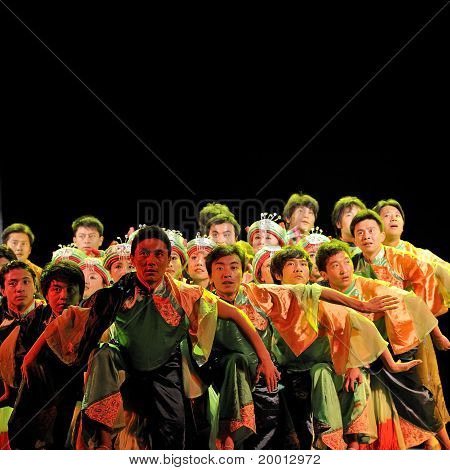 chinese Qiang ethnic dancers perform on stage