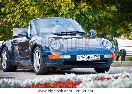 Dark blue Porsche on exhibition parking