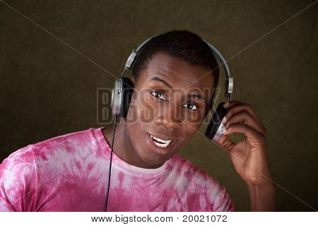 Young Man Takes Off His Headphones