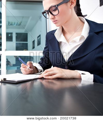 Businesswoman Writing A Contract