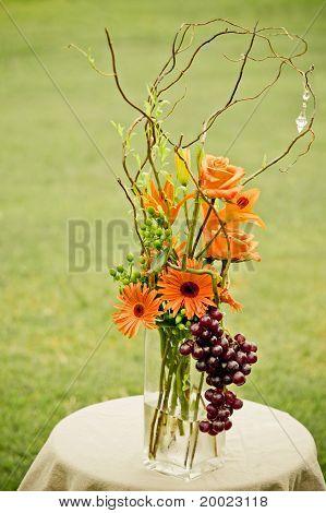 Floral centerpiece on grassy field