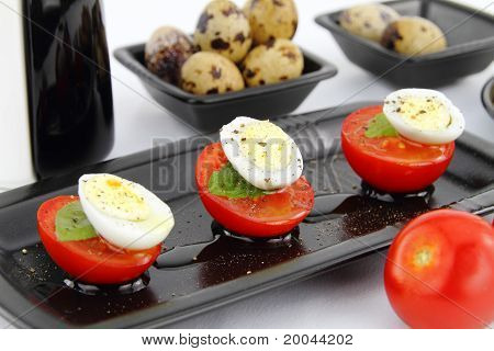 Quail Eggs And Tomatoes