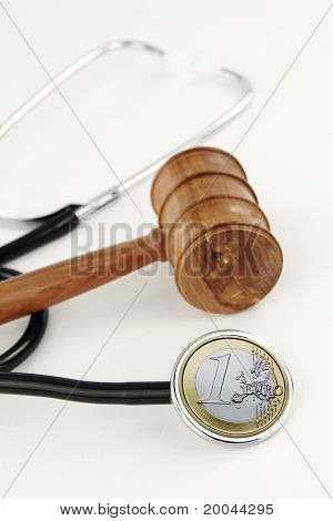 Judge's Gavel And Stethoscope With Euro Money