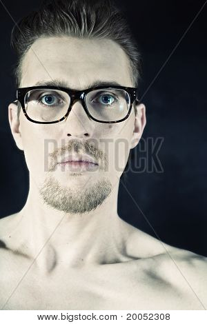 Portrait Of A Young Man In Glasses