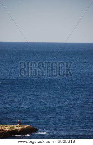 Small Fisherman In Big Ocean