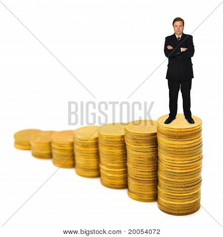 Businessman On Money Stairs