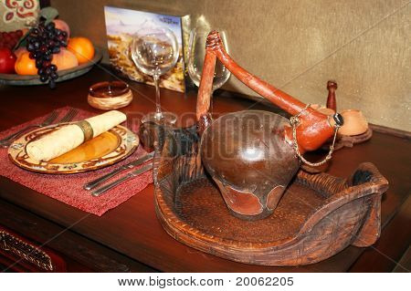 Wooden Vessel On A Tray