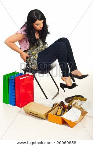 Woman Having Hard Choice At Shoes