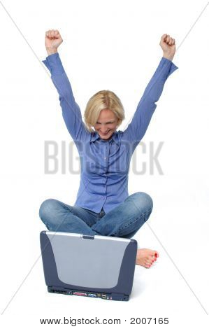 Attractive Excited  Blond With Laptop