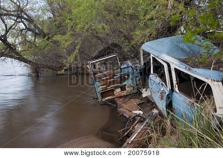 Junk Cars On River