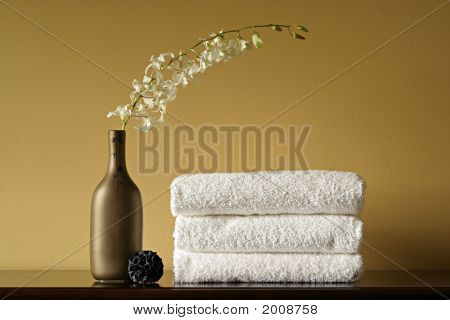 White Spa Towels With Flowers In Vase