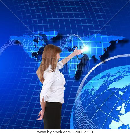 Young girl touching a virtual surface.