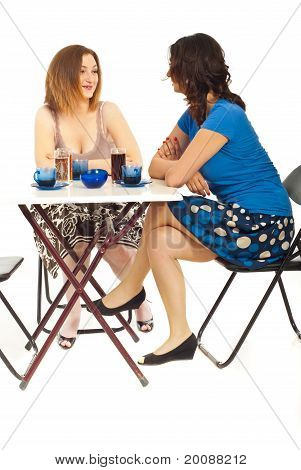 Two Women Having Conversation At Coffee