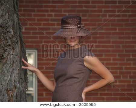 Woman Posing By The Tree