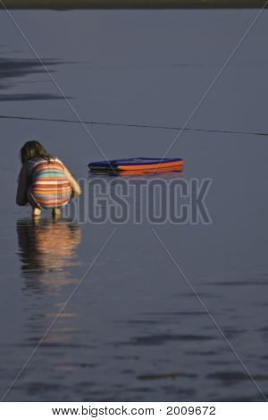 Girl Playing At Beach
