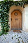 stock photo of wooden door  - Wooden door in a medieval Bavarian town Rothenburg ob der Tauber Germany - JPG