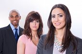 pic of multicultural  - Multicultural business team three smiling young people - JPG