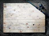 Top view of fishing nets and spinning rod on the wooden background. poster