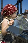 Little Girl With A City Map. Travel poster