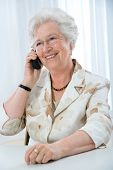 senior  woman using telephone