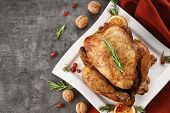 Plate with tasty whole roasted turkey on table poster