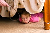 stock photo of domestic violence  - The child hides under a bed - JPG