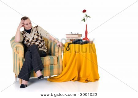 Pensive Woman In Sofa