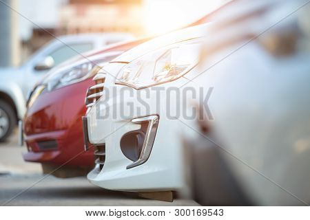 poster of Cars Parked In The Parking Lot, Close-up. Cars For Sale Stock Lot Row. Car Dealer Inventory.