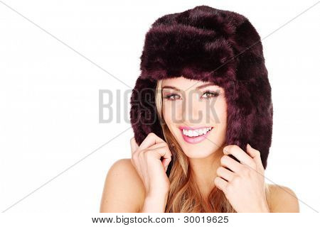 Happy smiling woman in winter fur hat with earflaps isolated on white