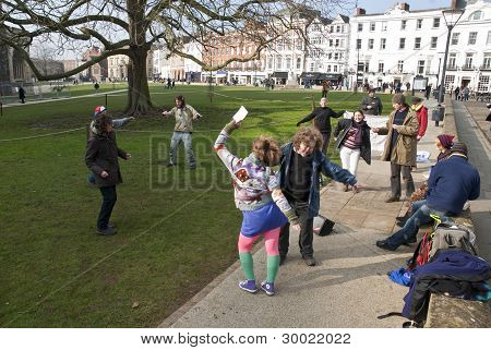 Exeter Occupy Activists Dance On Exeter Cathedral Green During Their Official Leaving Event From The