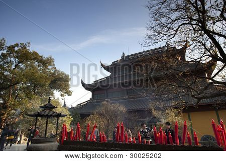 HANGZHOU, CHINA - NOVEMBER 26: Red candles fill the altar at the Mahavira Hall, Lingyin Temple on November 26, 2011 in Hangzhou, China. Buddhism is enjoying a revival in modern liberal China.