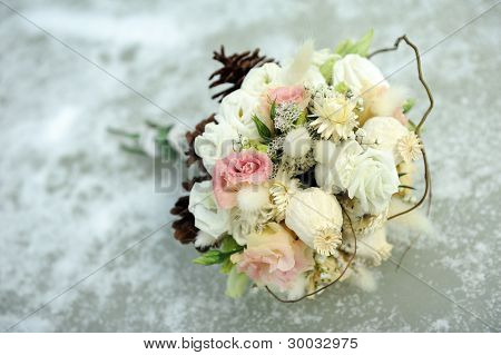 Wedding Bouquet Laying On Ice
