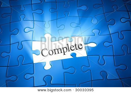 An image of a blue jigsaw puzzle with the word complete