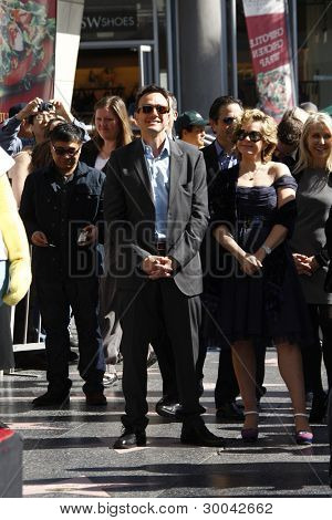 LOS ANGELES, CA - FEB 14: Hank Azaria; Yeardley Smith at a ceremony as Matt Groening receives a star on the Hollywood Walk Of Fame on February 14, 2012 in Los Angeles, California