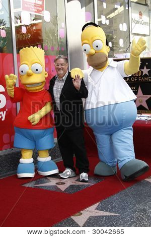 LOS ANGELES, CA - FEB 14: Bart Simpson; Matt Groening; Homer Simpson at a ceremony as Matt Groening receives a star on the Hollywood Walk Of Fame on February 14, 2012 in Los Angeles, California