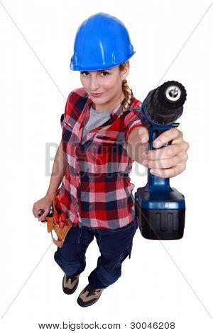 A female handyman with a drill.