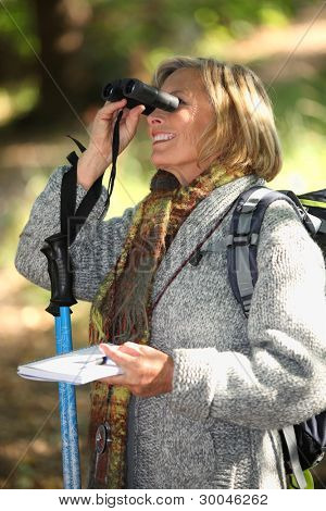 Woman in woods orienteering
