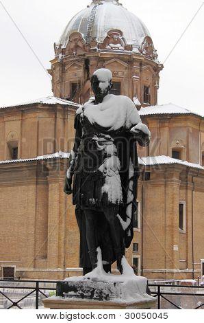 Statue of roman emperor Julius Caesar under snow