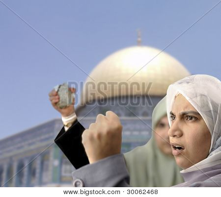 Angry Palestine women fighting with rocks in hands