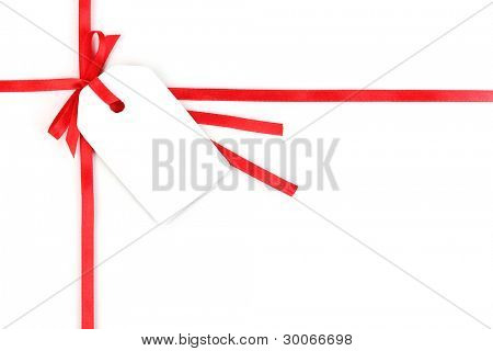 Blank gift tag with bow on red satin ribbon isolated on white