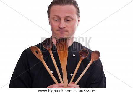 Cook Is Holding Five Cooking Spoons