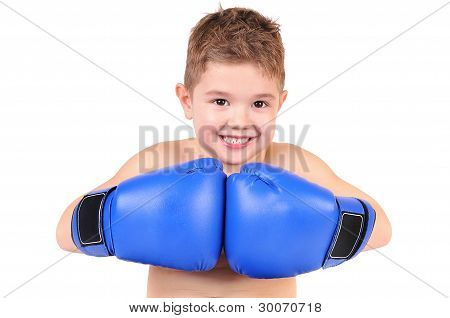 A little boy wearing a pair of boxing gloves