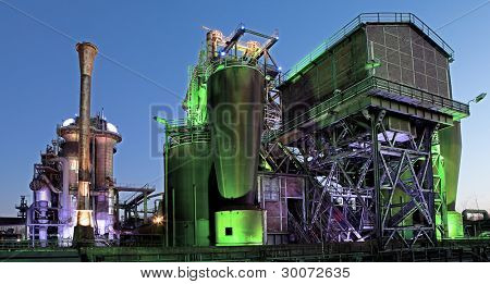 steel industry blast furnace factory or plant abandoned old industrial architecture at night with colored lights Landschaftspark Duisburg, Germany