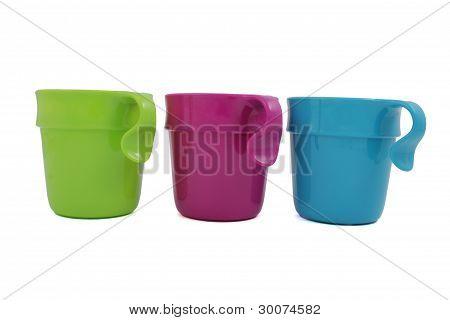 Three plastic mugs