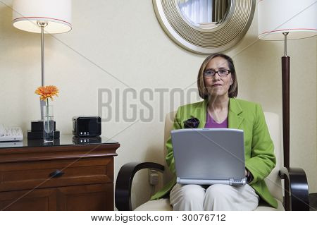 Businesswoman in hotel with laptop