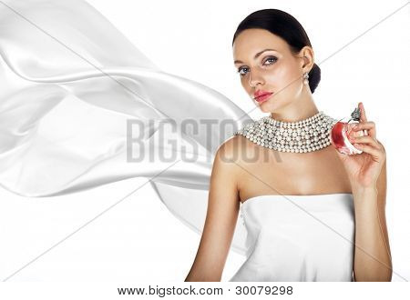 Elegant tanned woman with perfume and pearl jewellry