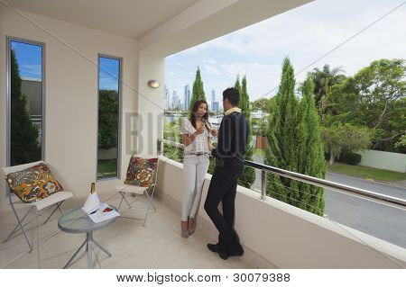 Young Couple On Balcony