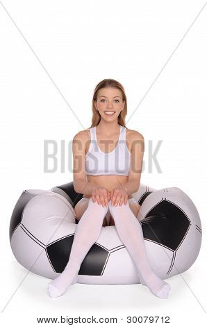 woman on an inflatable soccer chair