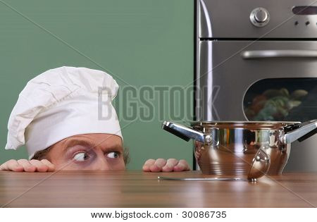 Funny Young Chef Strange Looking At Pot