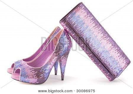 Pare Of Pink Shiny Shoes And Matching Bag Isolated On White Background.